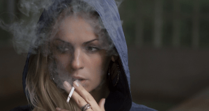 croped-picture-of-a-girl-smoking