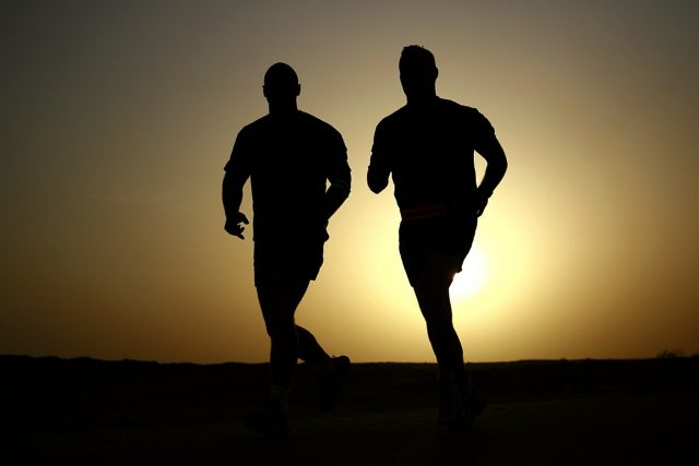 Picture-of-two-guys-jogging-in-eveining