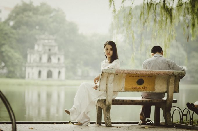 An-Image-of-man-and-woman-sitting-of-bench