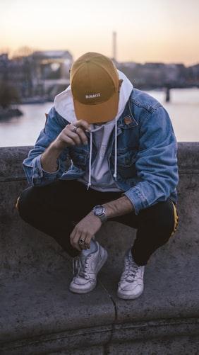 A-man-posing-roadside-with-denim-jacket