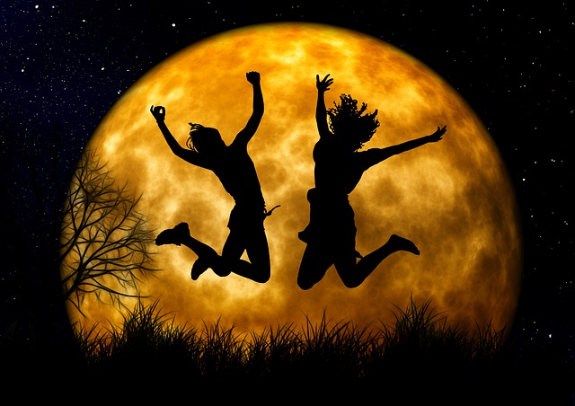 A-joyfull-picture-captured-where-who-person-jumping-in-front-of-big-moon